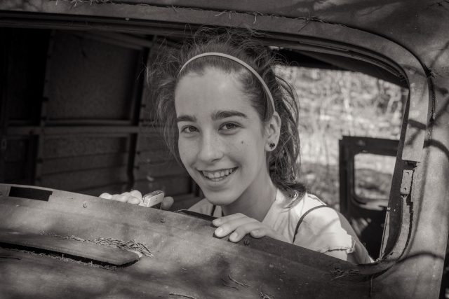 "Lanie in the 1930s Dodge ""Humpback"" Panel Van at Busiek"