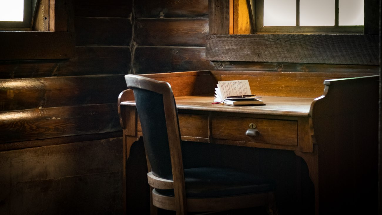 Photograph of a writing table or desk in a rustic environment