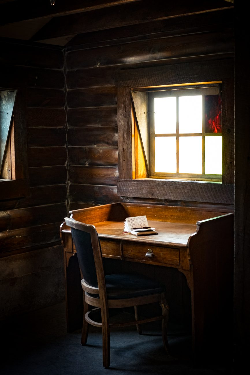 Photograph of a writing desk in a rustic environment
