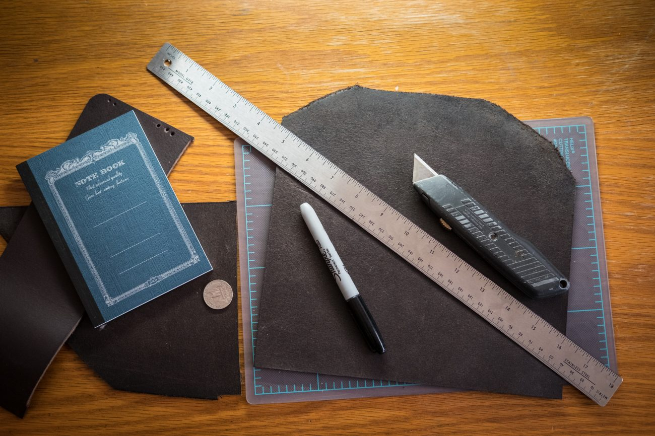 leather, craft knife and rule - the essentials for making a new leather bullet journal cover