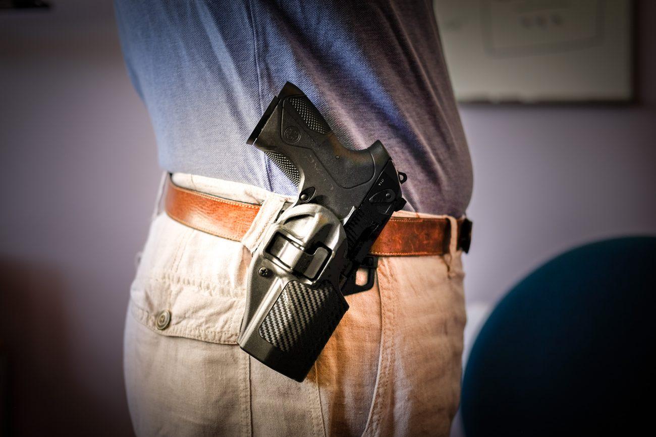 Beretta PX4 Storm Compact 9mm semiautomatic handgun in a  BLACKHAWK! Serpa CQC Carbon Fiber Appliqué Finish Concealment Holster