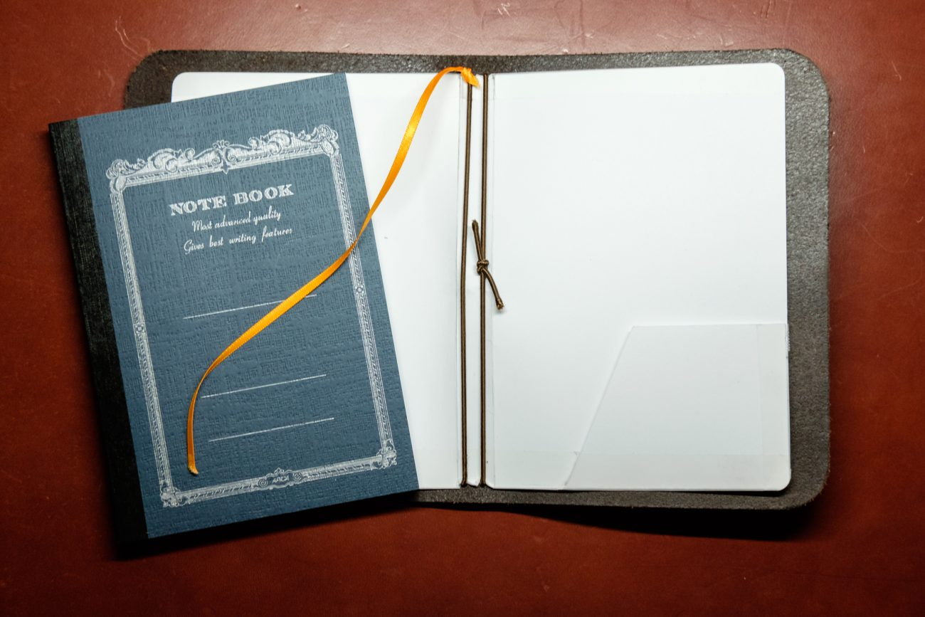 Photograph showing how to lace the shockcord in a home made journal cover.