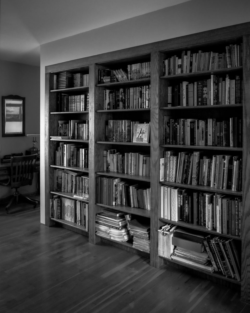 Black and White Photograph of a hand-built wooden bookcase